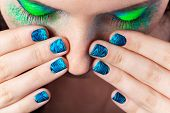 Woman's Lips With Beautiful Multicolor Minx Nails And Make-up