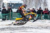 Race of sportsman on snowmobile