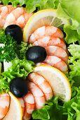Sea Foods - Shrimps. Garnished With Fresh Raw Salad Leaf Olive And Lemon.