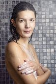 Attractive Woman Soaping Herself In The Shower