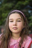 Portrait of a little brunette girl with long hair