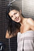 Woman With Wet Hair Standing In A Shower