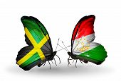 Two Butterflies With Flags On Wings As Symbol Of Relations Jamaica And Tajikistan