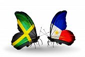 Two Butterflies With Flags On Wings As Symbol Of Relations Jamaica And Philippines