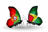 Two Butterflies With Flags On Wings As Symbol Of Relations Portugal And Guyana