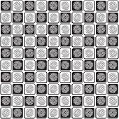 Seamless Pattern With Abstract Flowers On A Black And White Squares