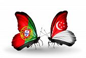 Two Butterflies With Flags On Wings As Symbol Of Relations Portugal And Singapore