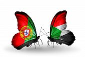 Two Butterflies With Flags On Wings As Symbol Of Relations Portugal And Sudan