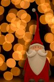 Santa Claus against a background of golden circles