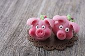 Marzipan pig on wooden background