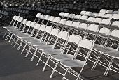 Empty Rows Of White Chairs