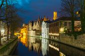 Night cityscape with a tower Belfort and the Green canal in Brug