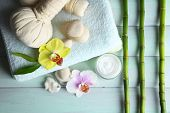 Spa treatments with orchid flowers on wooden table background