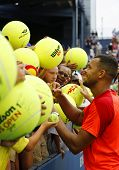 Professional tennis player Jo-Wilfried Tsonga signing autographs after US Open 2014 match