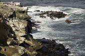 Sea Water Breaking On Rock Formations