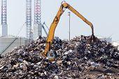 stock photo of scrap-iron  - A scrap metal dump with a crane - JPG