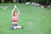 Young Beautiful Woman In Yoga Pose On Lawn