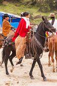 Youngs Latin Cowboy Woman riding horses
