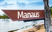 Manaus wooden sign with a lake background