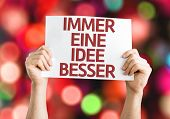 Getting a Better Idea (in German) card with colorful background with defocused lights