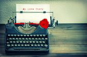 Vintage Typewriter With White Paper And Red Rose Flower. Love Story