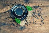 Black Coffee With Beans. Retro Style With Tilt-shift Effect