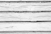 White wooden planks in rusric fence.