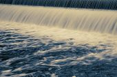 pic of save water  - Long exposure showing water patterns of dam water flowing - JPG