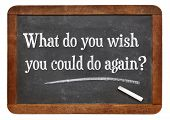 What do you wish you could to again?  A question in white chalk text  on a vintage slate blackboard