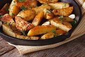 Baked Potatoes In A Frying Pan Close-up Horizontal