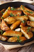 Baked Potatoes With Parsley And Garlic In A Frying Pan Vertical