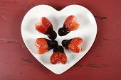 Happy Valentines Day Chocolate Dipped Heart Shaped Strawberries On Heart Shape White Plate On Red Vi