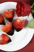 Happy Valentines Day Chocolate Dipped Heart Shaped Strawberries On White Plate On Red Vintage Wood B