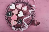Romantic Heart Shape Pink, White And Black Cookies On Vintage Baking Rack With Ribbon On Shabby Chic