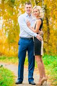 Young Beautiful Couple Posing In Park