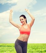 fitness and diet concept - smiling teenage girl in sportswear dancing