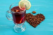 mulled Wine And Heart On A Blue Wooden Background