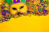 image of masquerade mask  - Assorted colorful Mardi Gras mask on yellow background - JPG