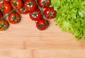 Lettuce And Tomatoes On Wooden Background