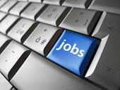 foto of key  - Online job search concept with jobs sign and symbol on a blue laptop computer key for website and online business - JPG
