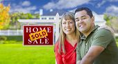 foto of real  - Happy Mixed Race Couple in Front of Sold Home For Sale Real Estate Sign and House - JPG