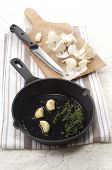 Garlic And Thyme In A Pan