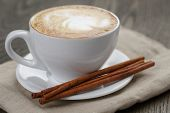 Cup Of Cappuccino With Cinnamon Sticks