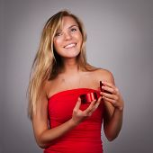 Blond Pretty Young Woman With Valentine's Present In Hands In Re