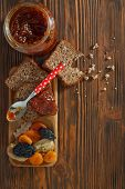 Wholemeal Bread With Apricot Jam Surrounded By Dry Fruit. Vintage/retro Style.