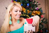 Pretty Woman With Present And Christmas Tree