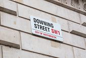 Downing Street Road Sign On House Wall