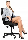 stock photo of crossed legs  - Businesswoman in office chair - JPG