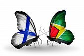 Two Butterflies With Flags On Wings As Symbol Of Relations Finland And  Guyana