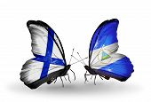 Two Butterflies With Flags On Wings As Symbol Of Relations Finland And Nicaragua